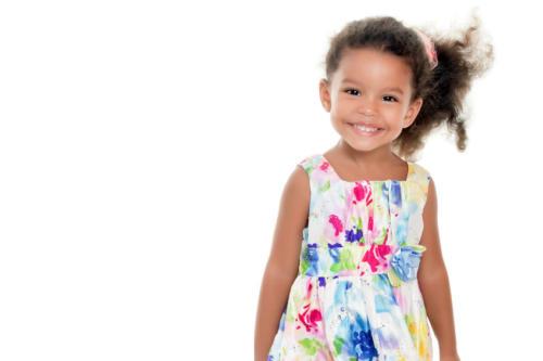 Cute small girl wearing a flowers summer dress