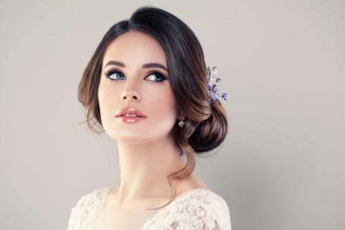 Perfect Fashion Model Woman with Beautiful Hairstyle. Prom or Br