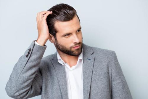 Close up portrait of handsome confident masculine man in jacket